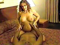 Curvy milf with incredible big tits grinds on a black cock in hotel room