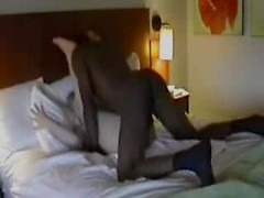 Wife on vacation fucks a black guy in her hotel bed and moans for him