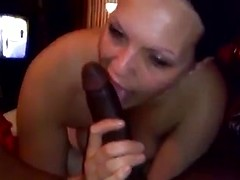Cheating chick with a ring on her finger goes down on a big black cock